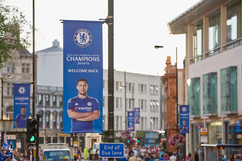 LONDON, UK - 08 AUG: Chelsea Stadium banners with crowd leaving match between Chelsea and Swansey City. In London, on 08 August 2015.